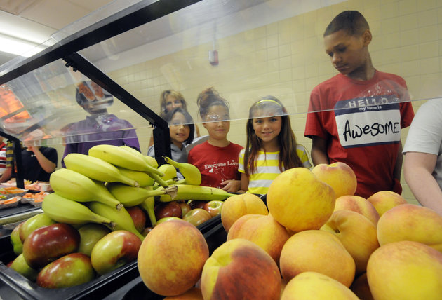 Students select food items from the lunch line of the cafeteria at Draper Middle School in Rotterdam, N.Y., Tuesday, Sept. 11, 2012. (AP Photo/Hans Pennink)