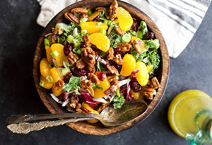 mixed salad with oranges, cranberries, and pecans